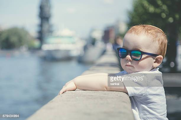 Portrait of a cute red-haired boy in sunglasses