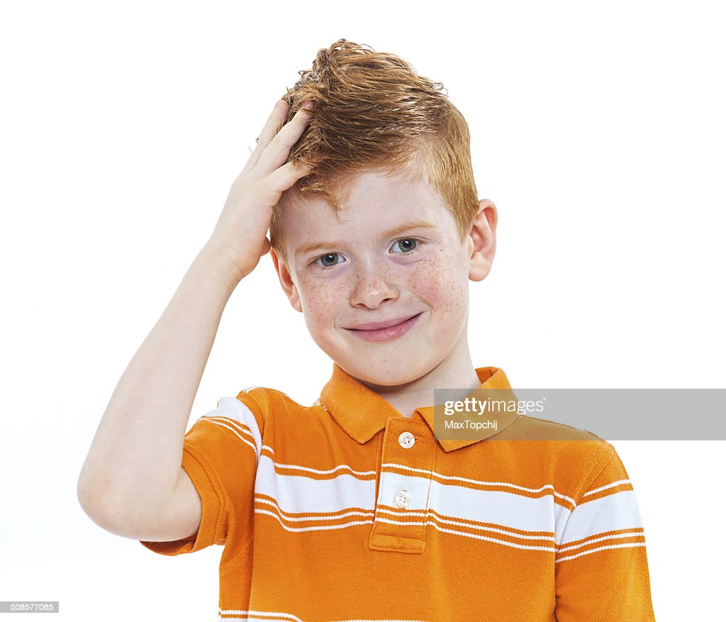 Portrait of a cute red-haired boy : Stock Photo