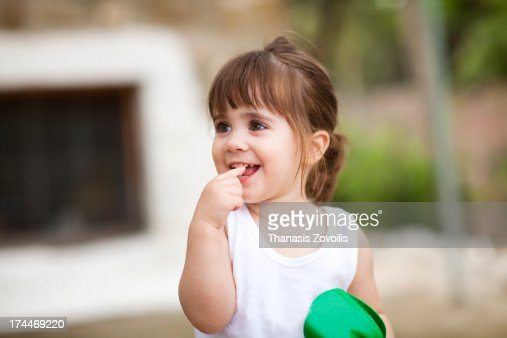 Cute Small Girl Portrait Of A Cute Small Girl Stock Photo  Getty Images