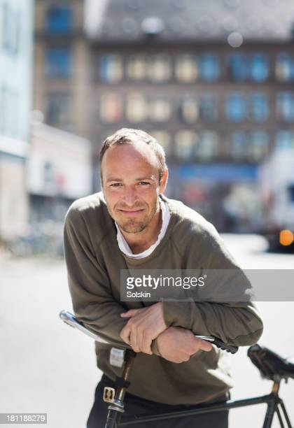 Portrait of a cyclist, leaning on bicycle