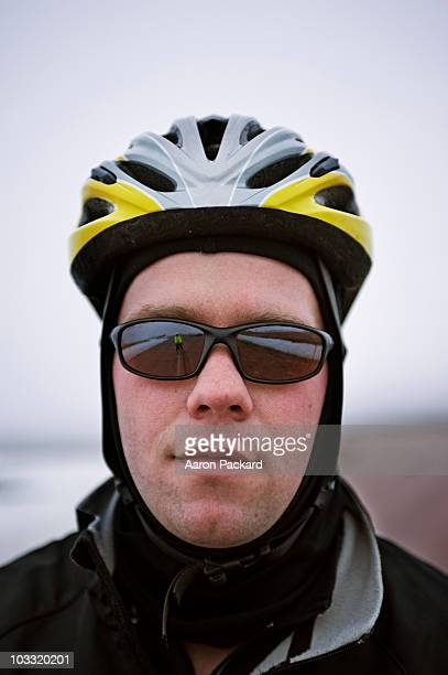 Portrait of a cyclist on a cold and foggy winter day.