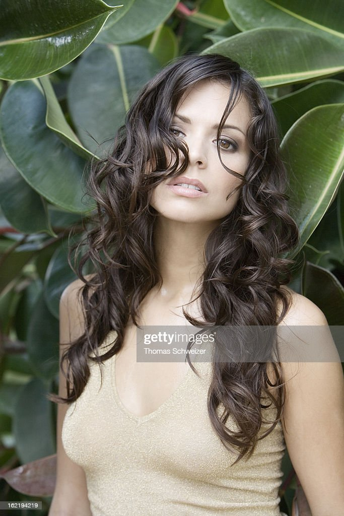 Portrait of a dark haired woman : Stock Photo