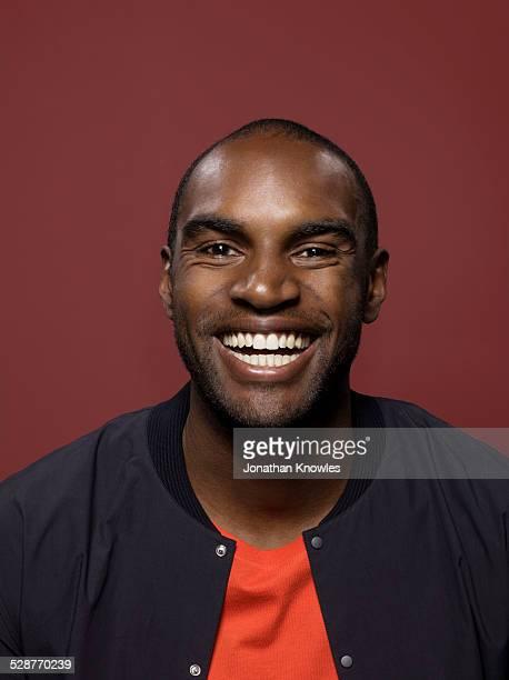 Portrait of a dark skinned male, smiling