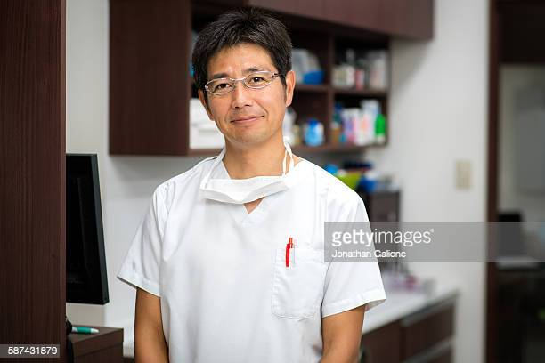 Portrait of a dentist looking at the camera