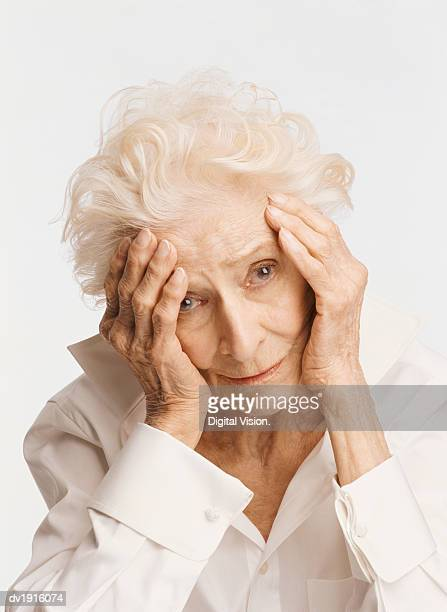 Portrait of a Depressed Senior Woman, Holding Her Head in Her Hands