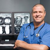 Portrait of a doctor with scans
