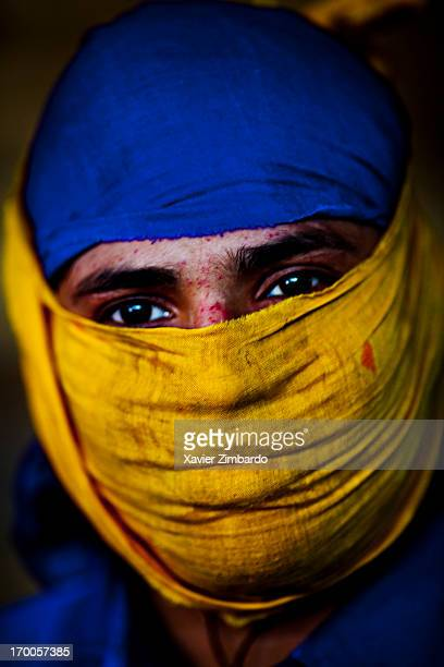 Portrait of a dyeing worker wearing a mask as a protective clothing against toxic substance on March 23 2009 in a textile factory Rajasthan India The...