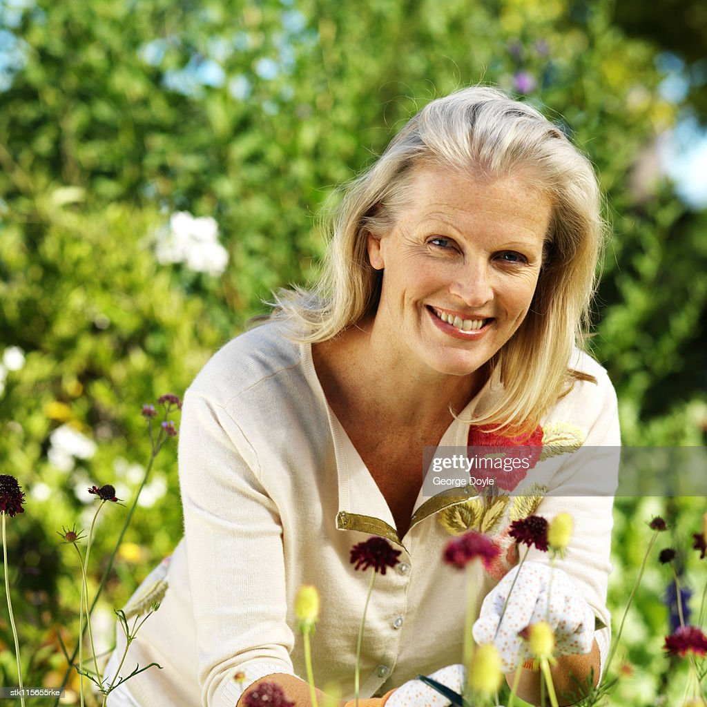 portrait of a elderly woman gardening : Stock Photo
