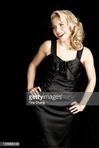 Portrait of a elegant lady in a black silk dress : Stock Photo
