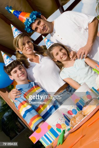 Portrait of a family celebrating a birthday party : Stock Photo