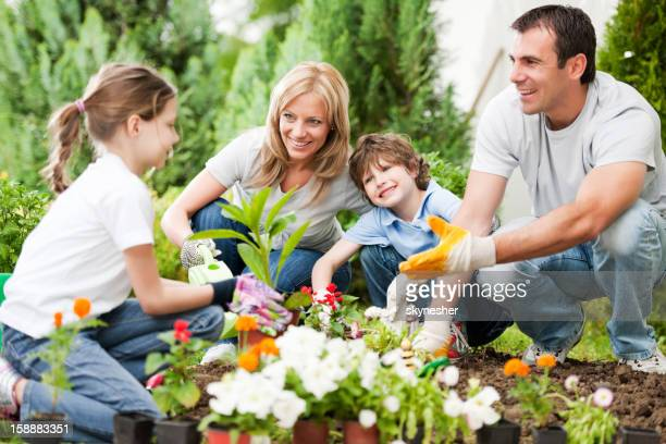 Portrait of a family gardening.