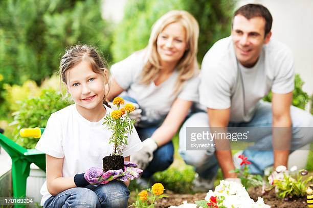 Portrait of a family gardening