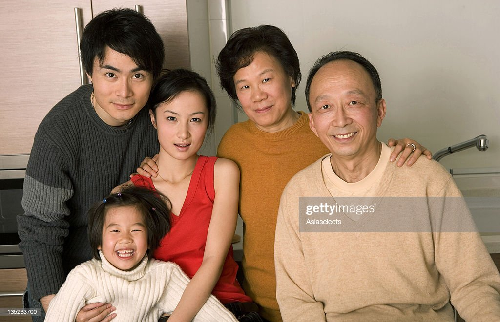 Portrait of a family members smiling : Stock Photo