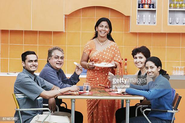 Portrait of a family sitting at the dining table