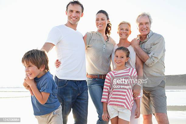 Portrait of a family smiling on beach