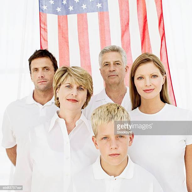 portrait of a family standing in front of the American flag