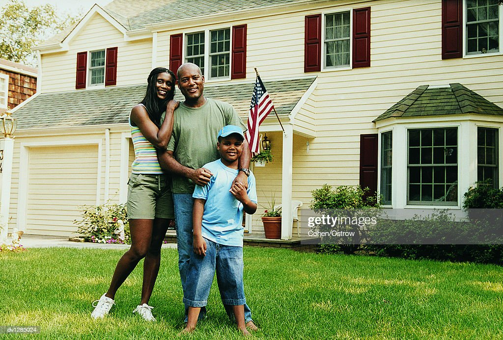 portrait of a family standing on a lawn in front of their home stock photo getty images. Black Bedroom Furniture Sets. Home Design Ideas