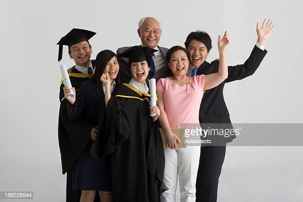 Portrait of a family standing together and laughing