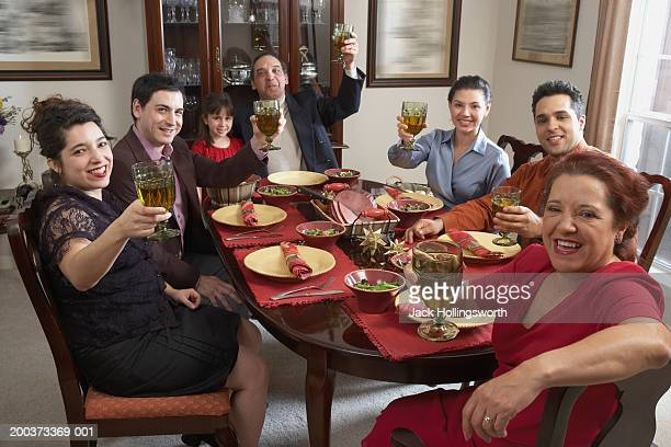 Portrait of a family toasting at the dining table