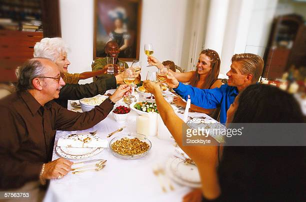 portrait of a family toasting at the dinner table