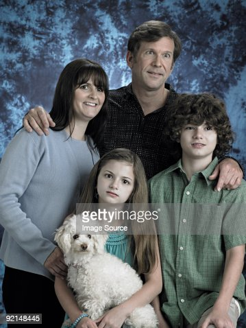 Portrait of a family with poodle