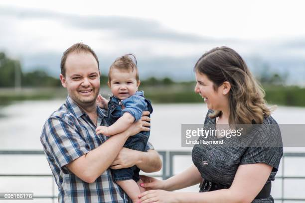 Portrait of a family with two parents and a baby boy in nature
