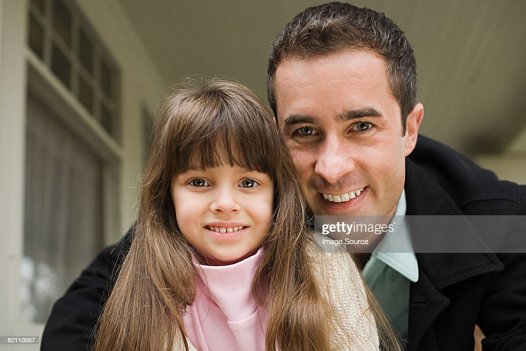 Portrait of a father and daughter : Stock Photo