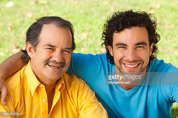 Portrait of a father and son smiling on a sunny day