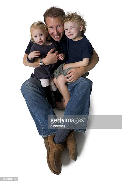 Portrait of a father holding his two daughters
