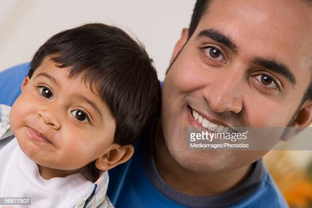 Portrait of a father with his son smiling