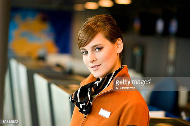 Portrait of a female airline check-in attendant