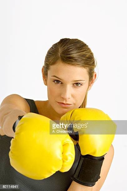 Portrait of a female boxer in a boxing stance