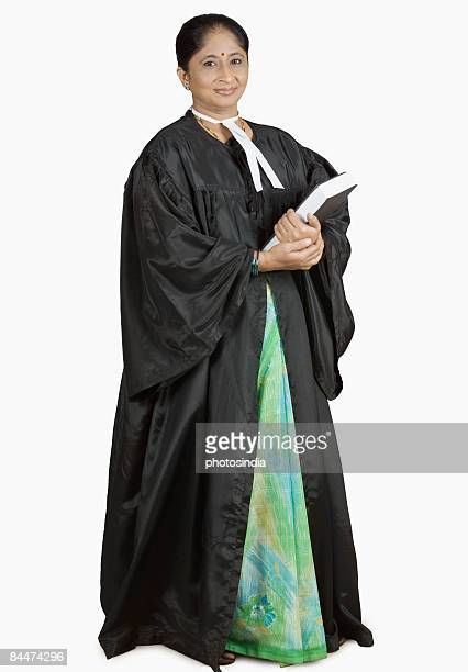 Portrait of a female lawyer holding a book
