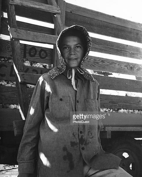 Portrait of a female migratory cotton picker standing next to the cotton wagon originally from Oklahoma now working at Eloy District Pinal County in...