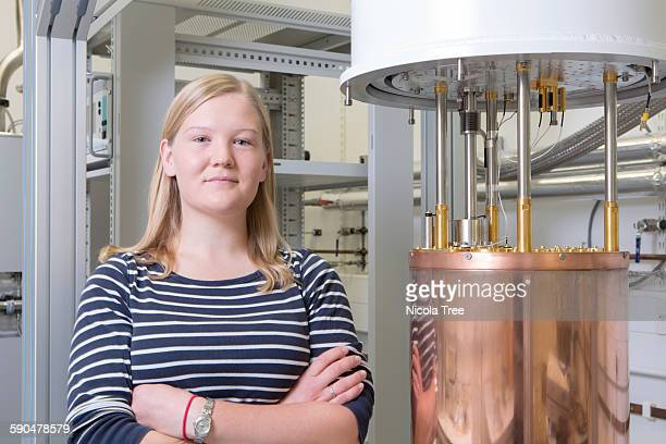 Portrait of a female physicist next to a dilution