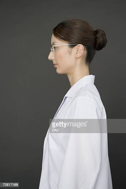Portrait of a female scientist, side view, black background