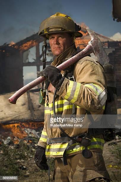 Portrait of a firefighter holding an axe