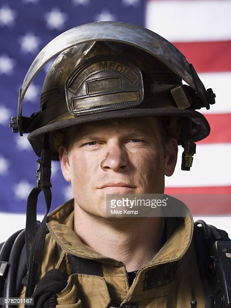 Portrait of a firefighter with US flag