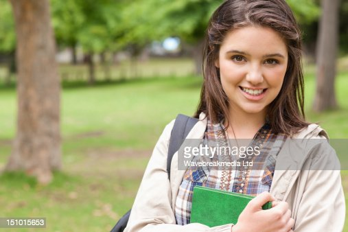 Portrait of a first-year student holding a textbook : Foto de stock