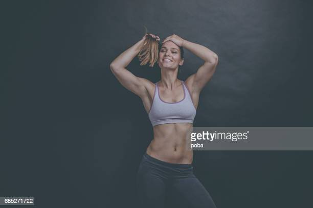 Portrait of a fit and toned  woman wearing a sports bra