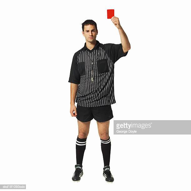 portrait of a football referee holding up a red card