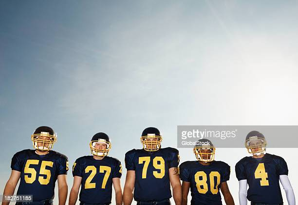 Portrait of a footballers against clear sky