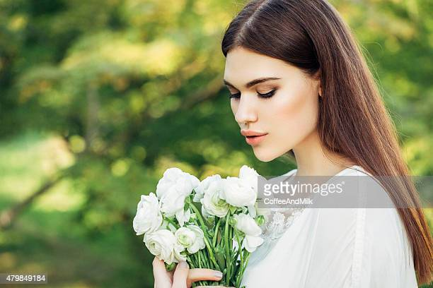 Portrait of a fresh and lovely bride with flowers