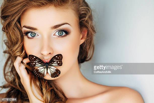 Portrait of a fresh and lovely woman with butterfly