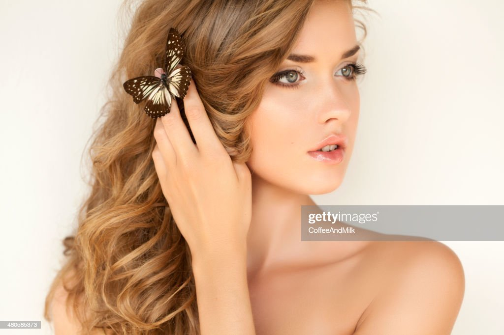 Portrait of a fresh and lovely woman with butterfly : Stock Photo