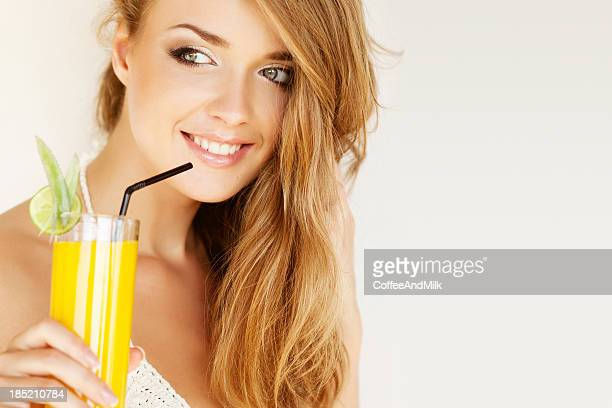 Portrait of a fresh and lovely woman with juice