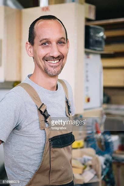 portrait of a friendly smiling carpenter