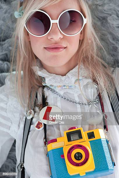 portrait of a funky woman with a bright camera