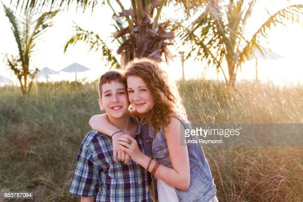 Portrait of a girl and a boy at sunset