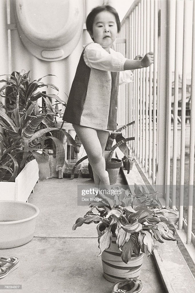Portrait of a girl at balcony : Stock Photo